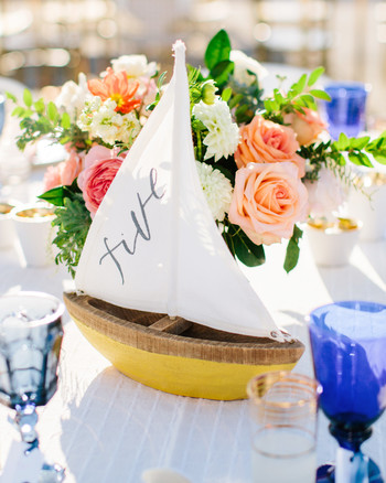 julie anthony real wedding table number sailboat : nautical wedding table settings - pezcame.com