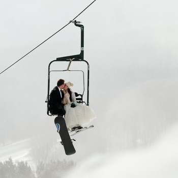 lauren and christian kissing on ski lift