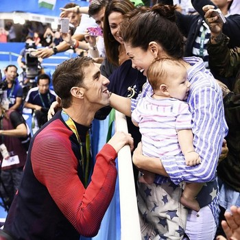 Michael Phelps Nicole Johnson and son Boomer at Olympics