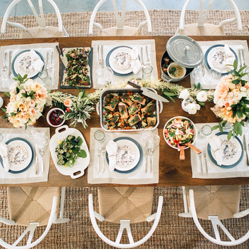 How to Choose Tabletop Décor When You're Serving a Family-Style Wedding Meal