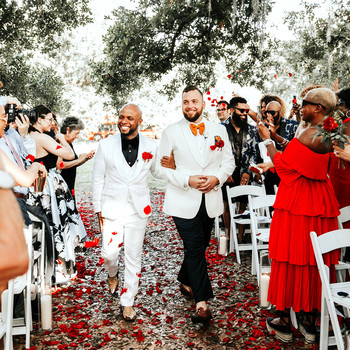 joe tim new orleans wedding grooms recessional petals