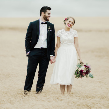 short wedding dress couple standing field