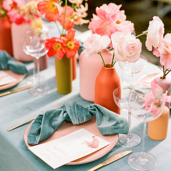 coral and teal wedding place setting with flowers