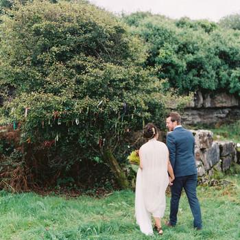 bride and groom walking bush