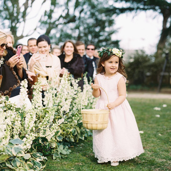 flower girl holding large wicker basket