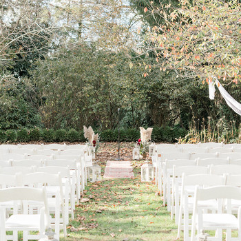 white wooden chairs wedding seating outdoor aisle