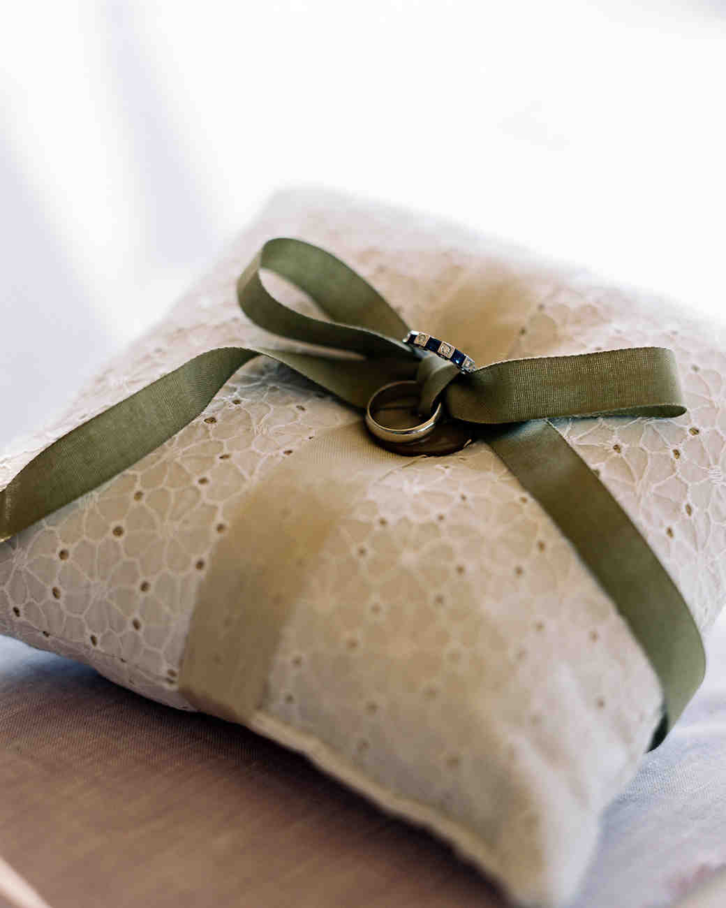 eyelet lace ring bearer pillow with green ribbon