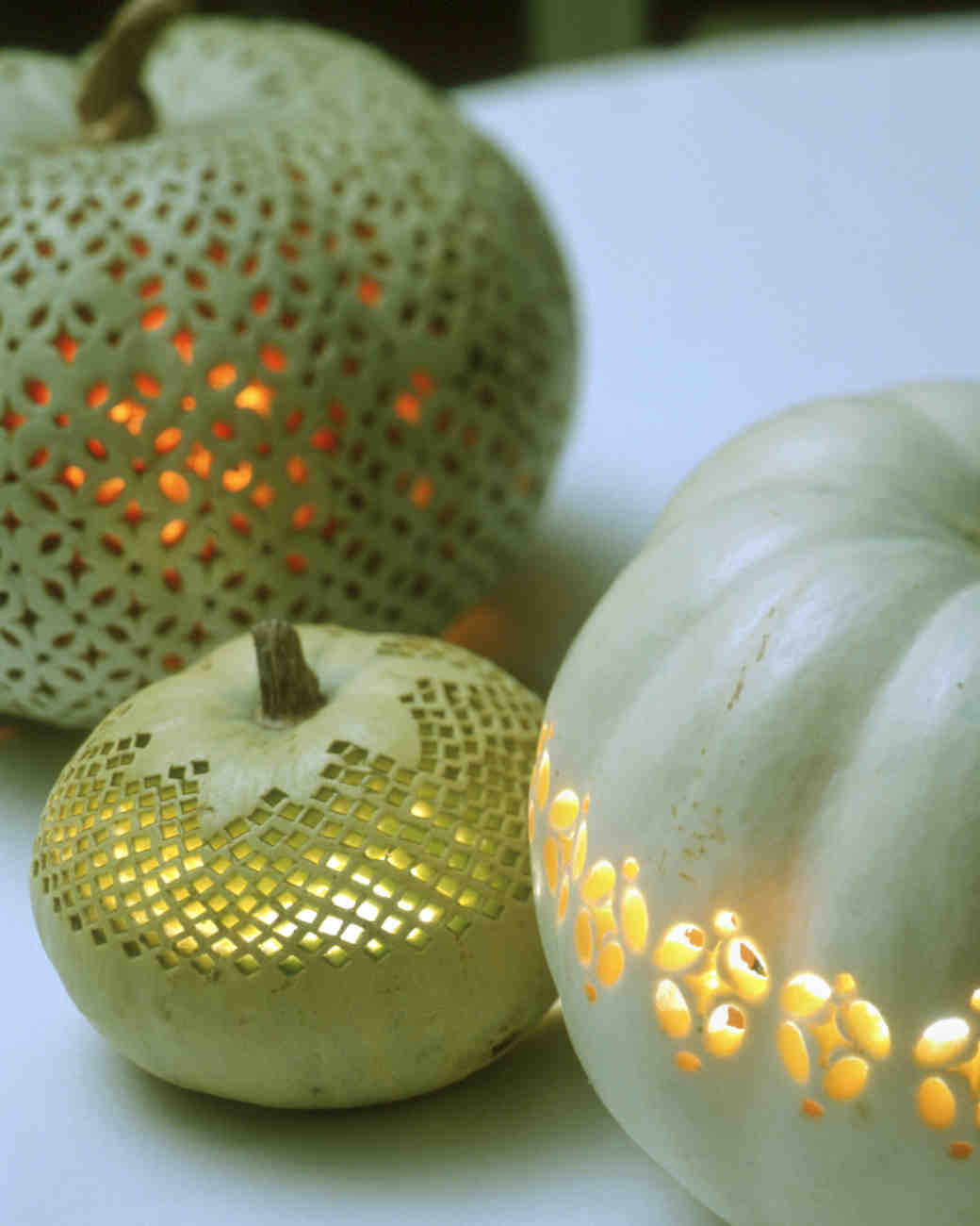 Lit Pumpkin Lanterns with Patterned Carvings