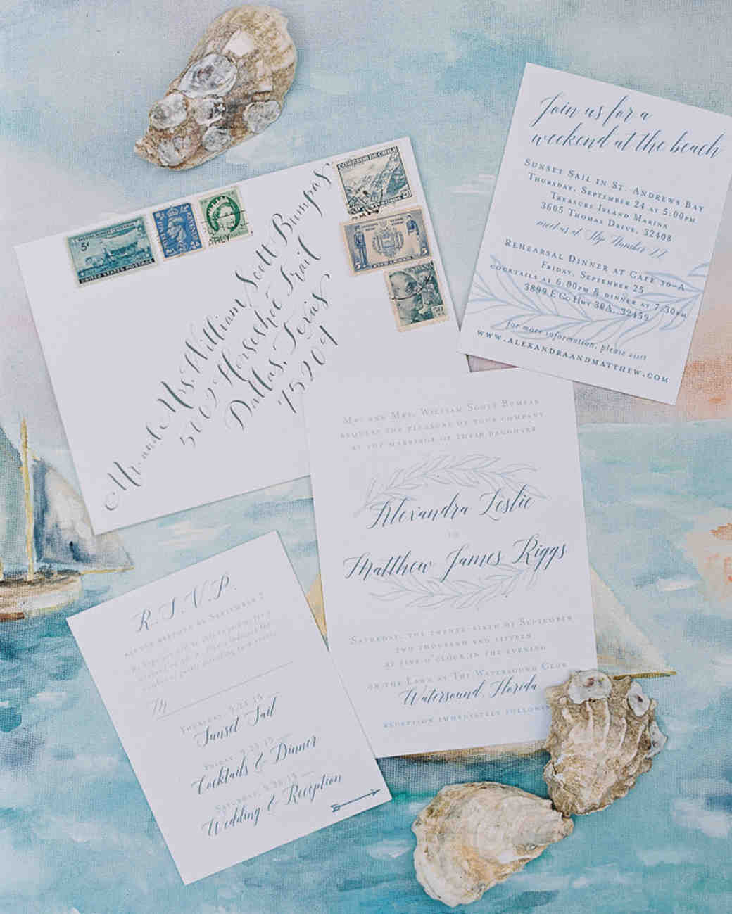 white and blue wedding invitation with leafy motif