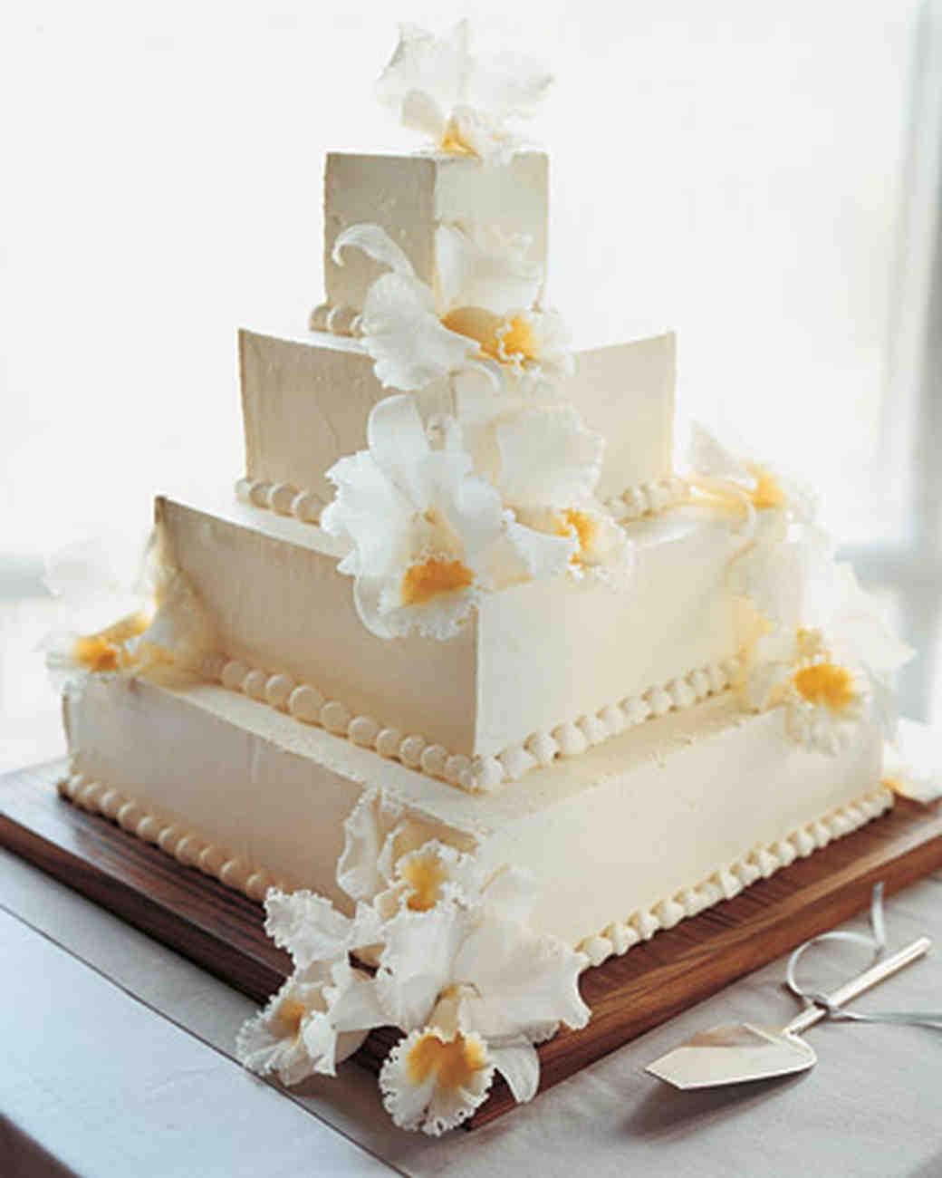 Four-Tiered Wedding Cake with Icing Beading and White and Yellow Orchids