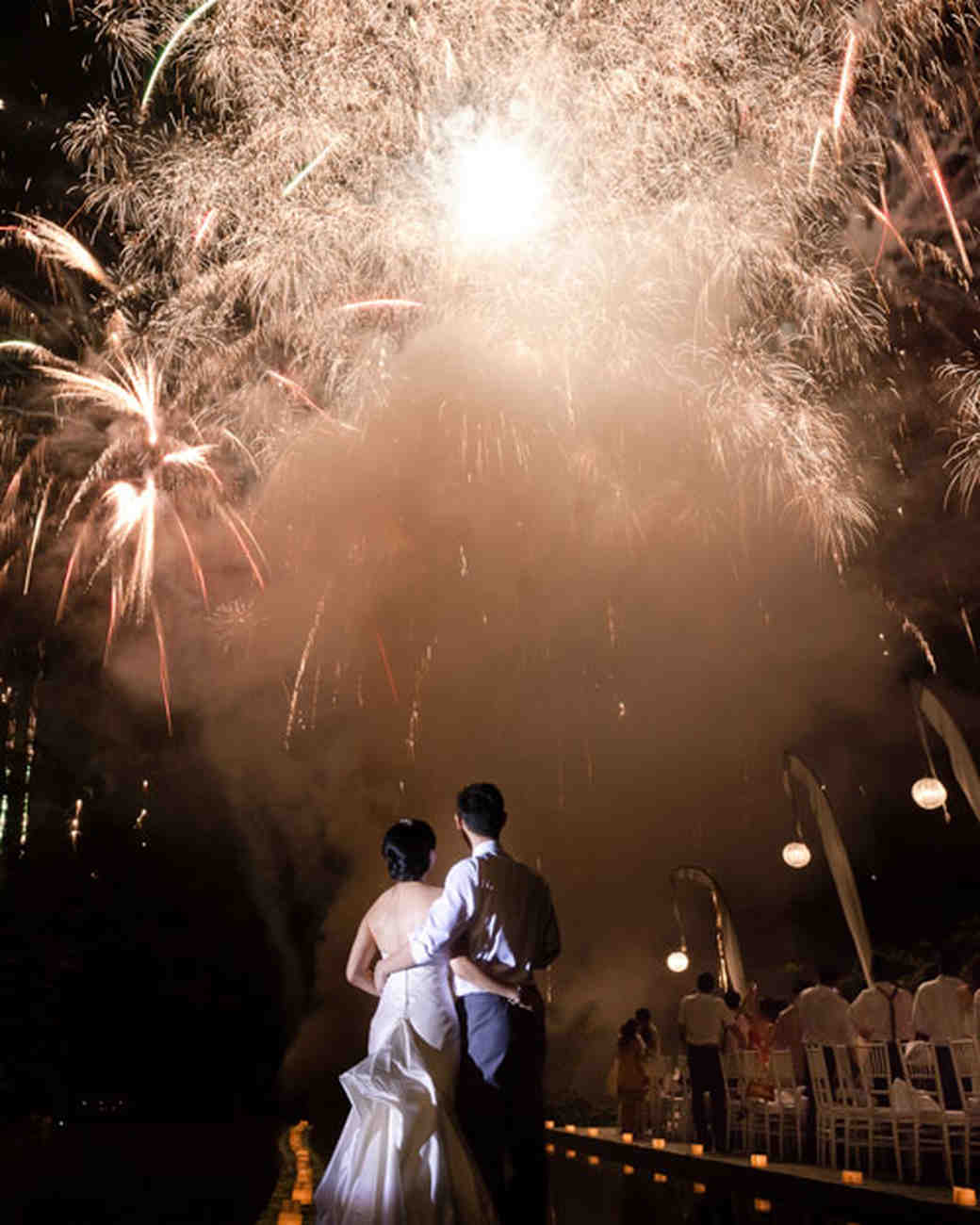 couple underneath fireworks