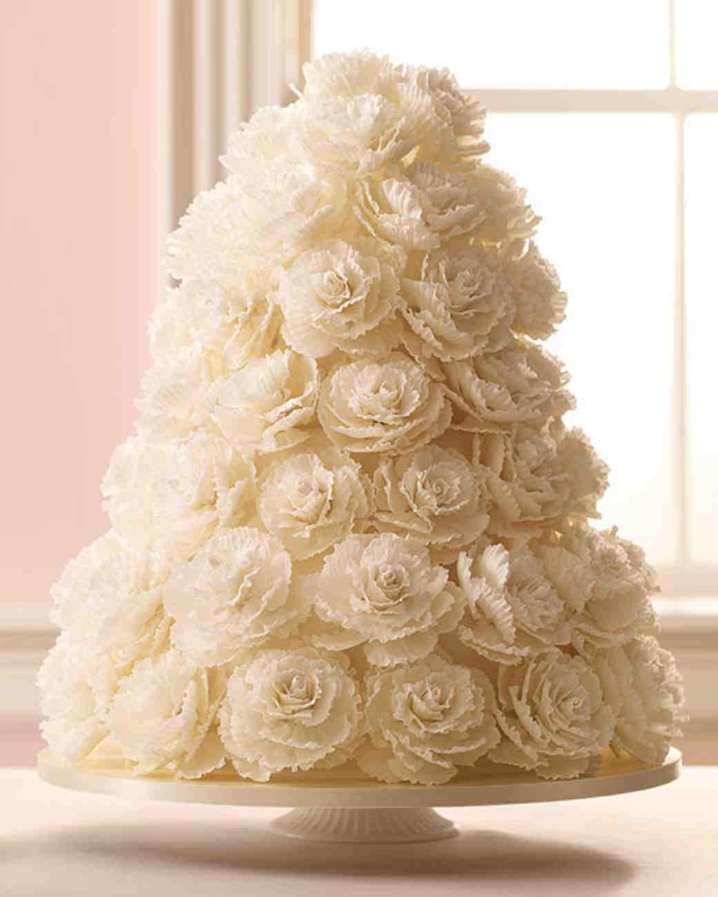 White Wedding Cake Covered in Sugar Rose Petals