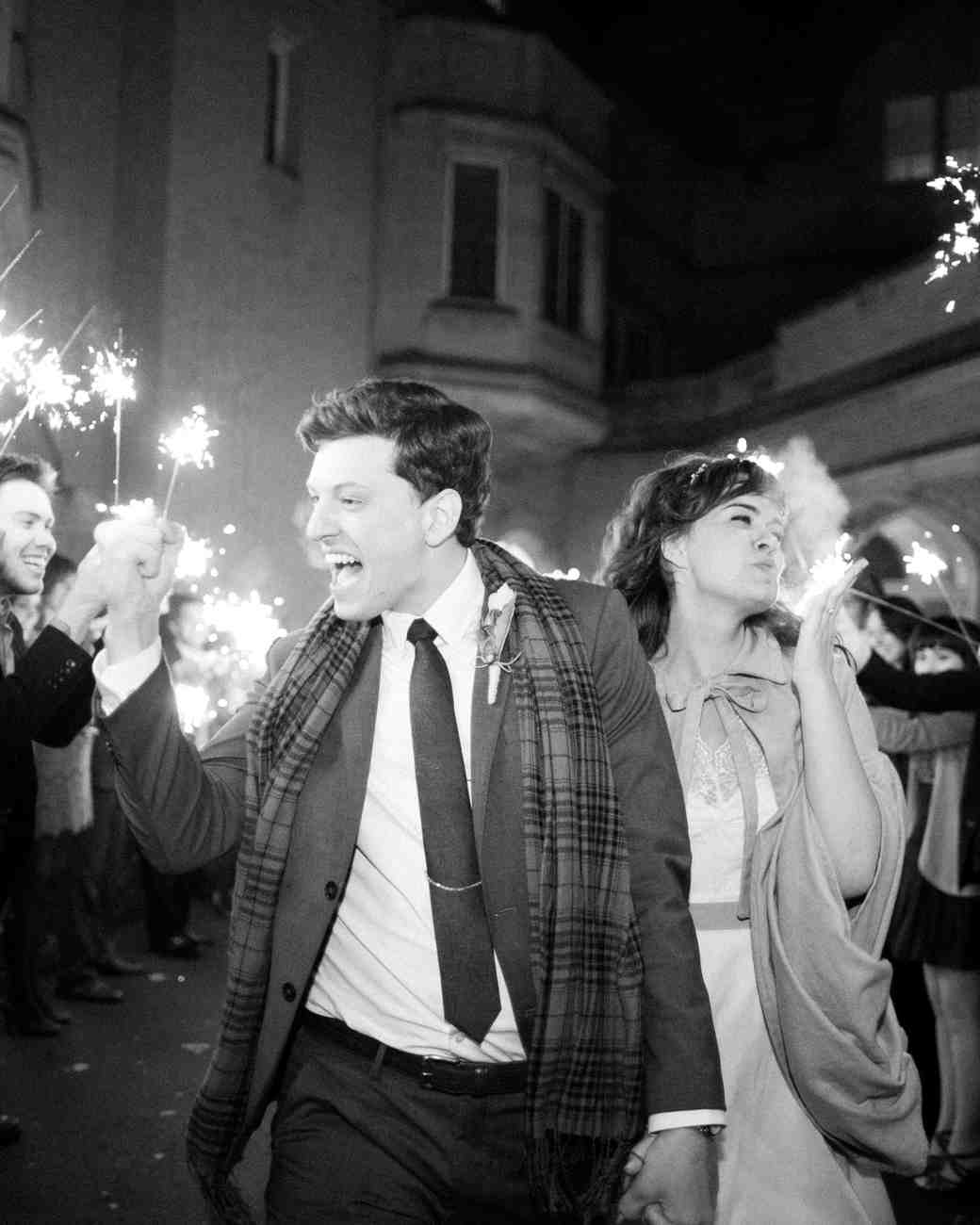 couple exiting through sparklers