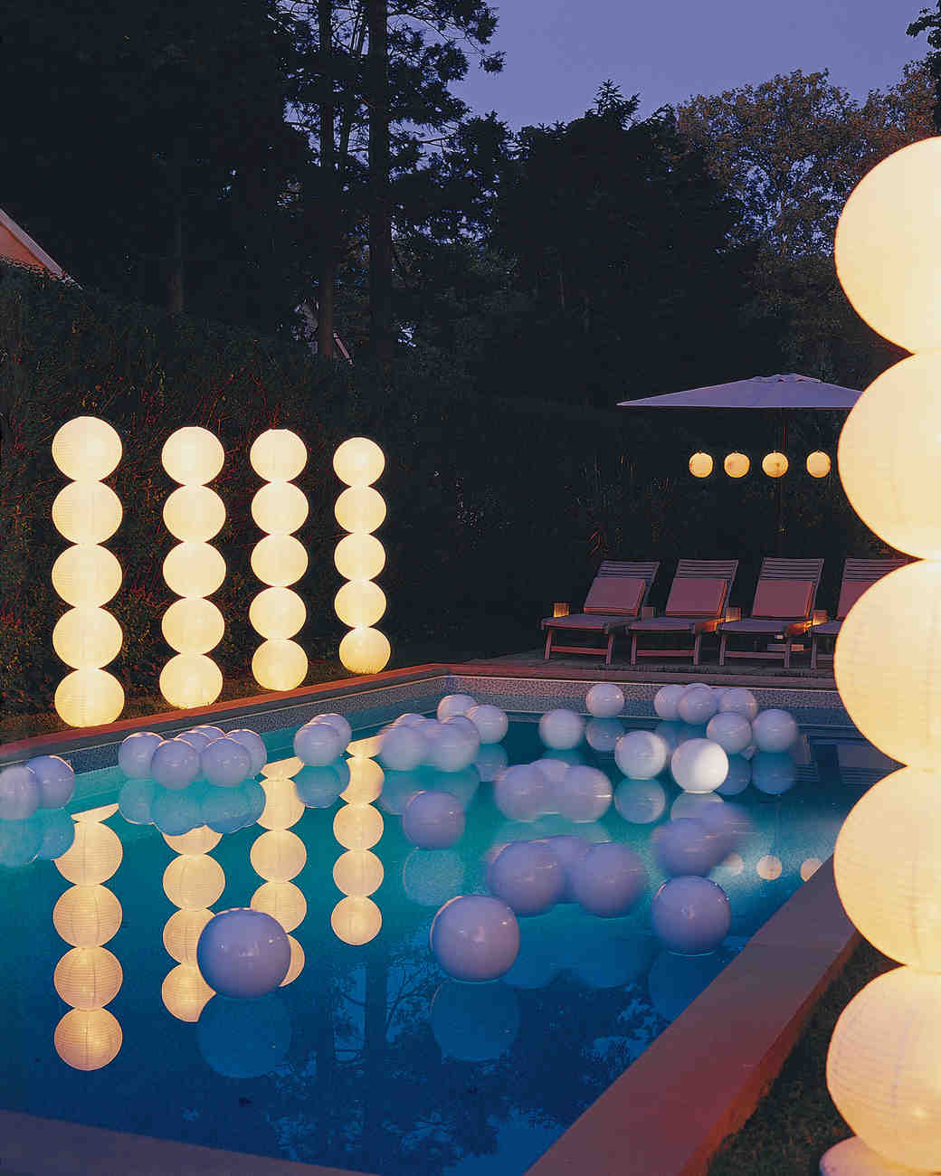 stacked light orbs by pool