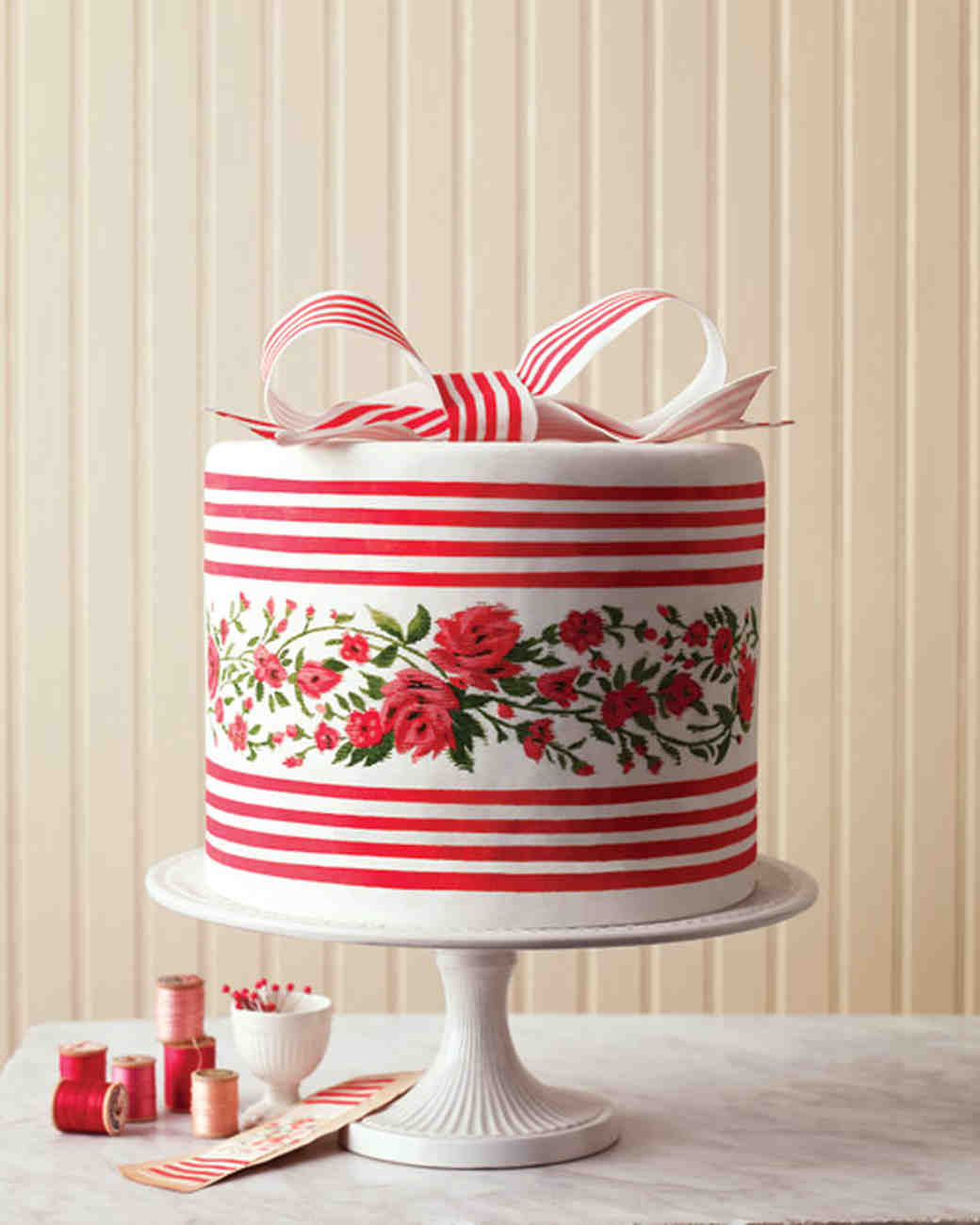 Red Striped Wedding Cake with Floral Details