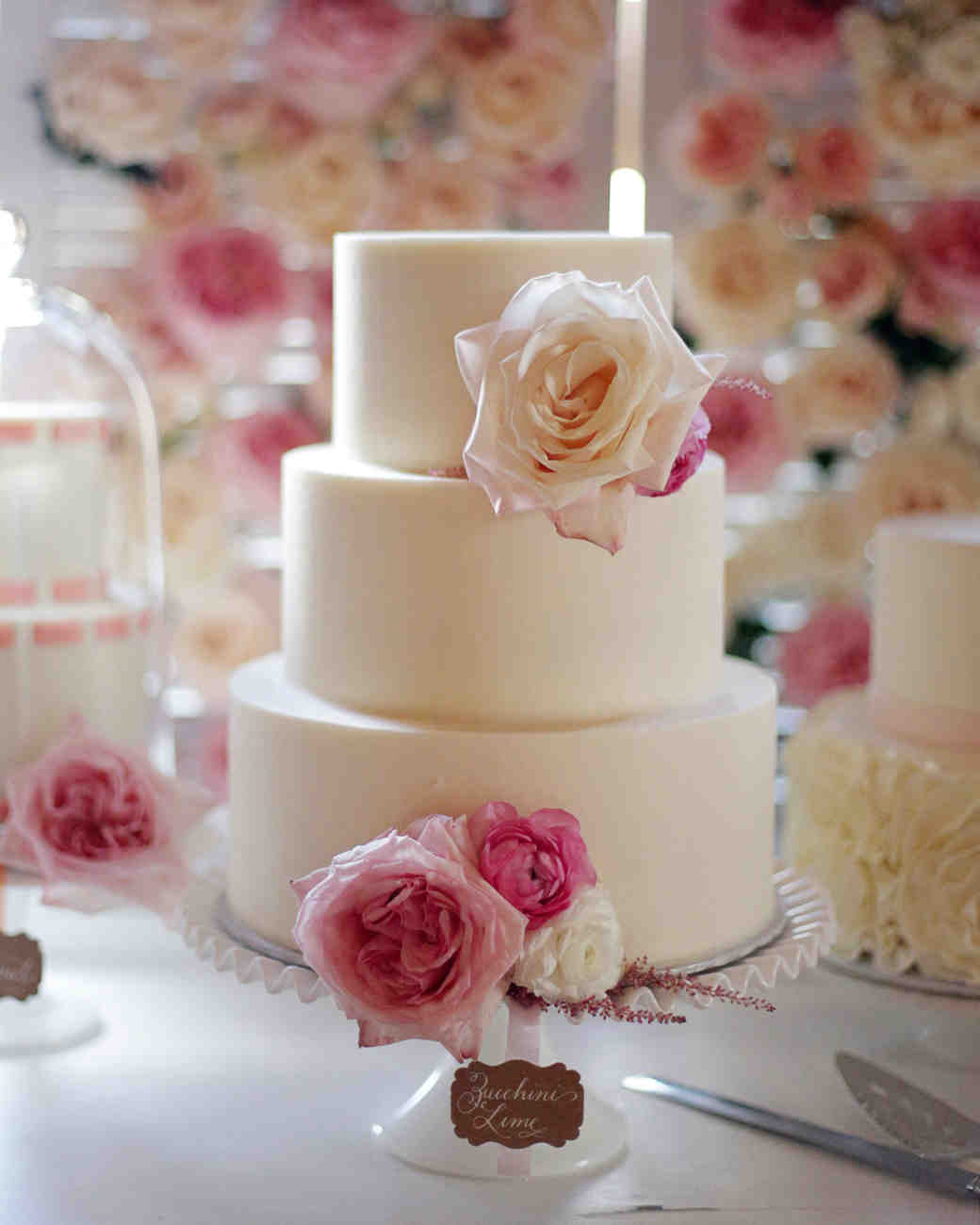 buttercream wedding cake with pink flowers
