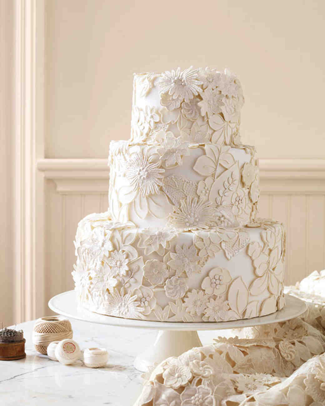 Three-Tiered White Wedding Cake with Floral Appliques