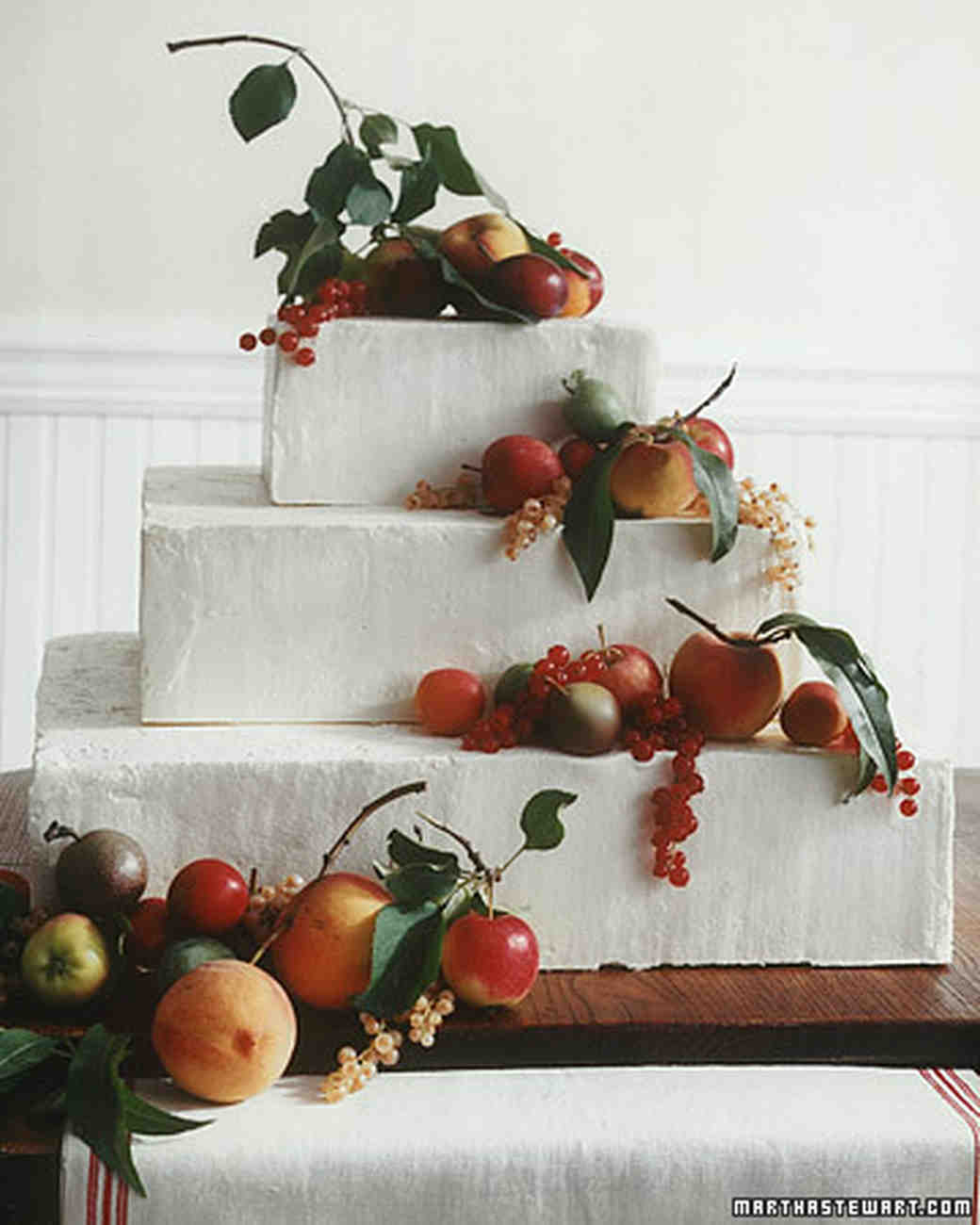 Wedding Cake with Orange and Red Fruits
