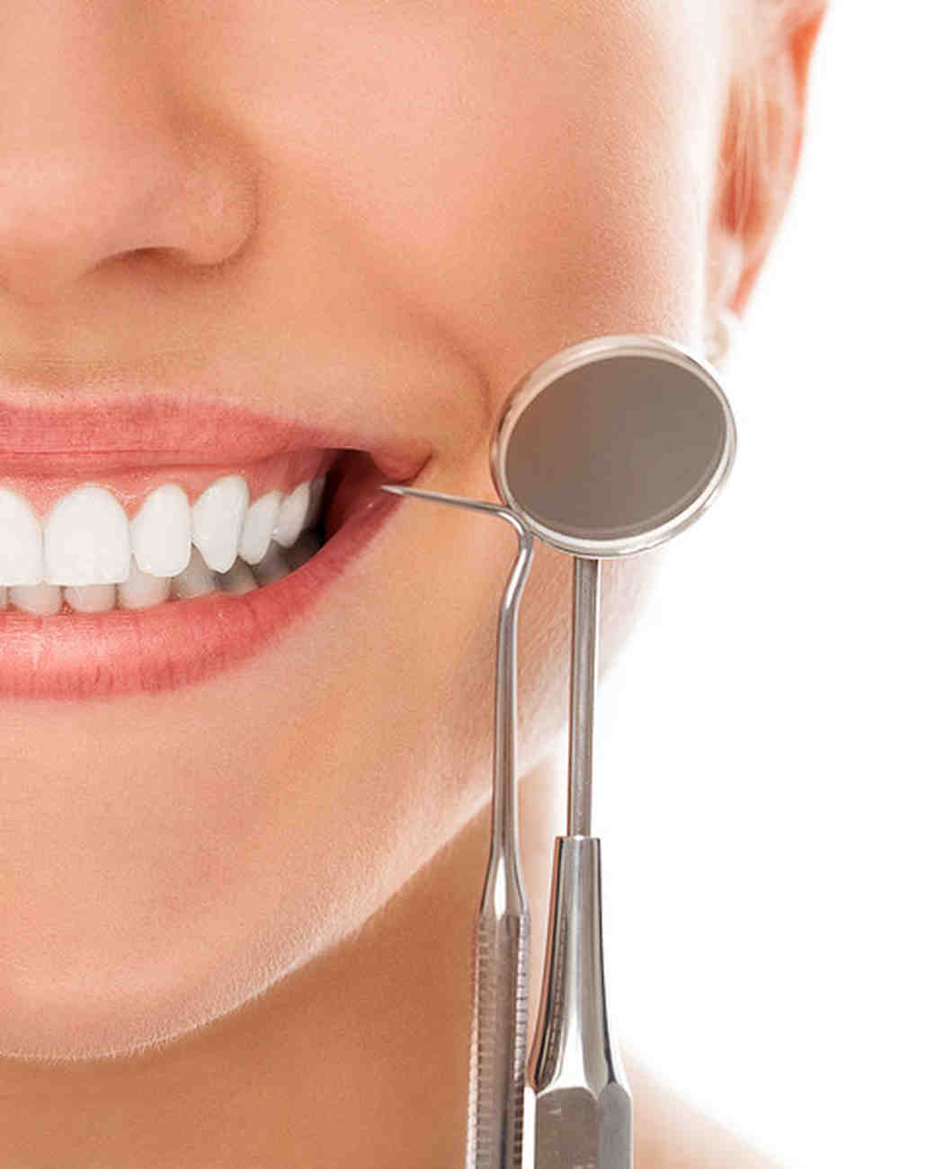 woman smiling at dentist appointment teeth