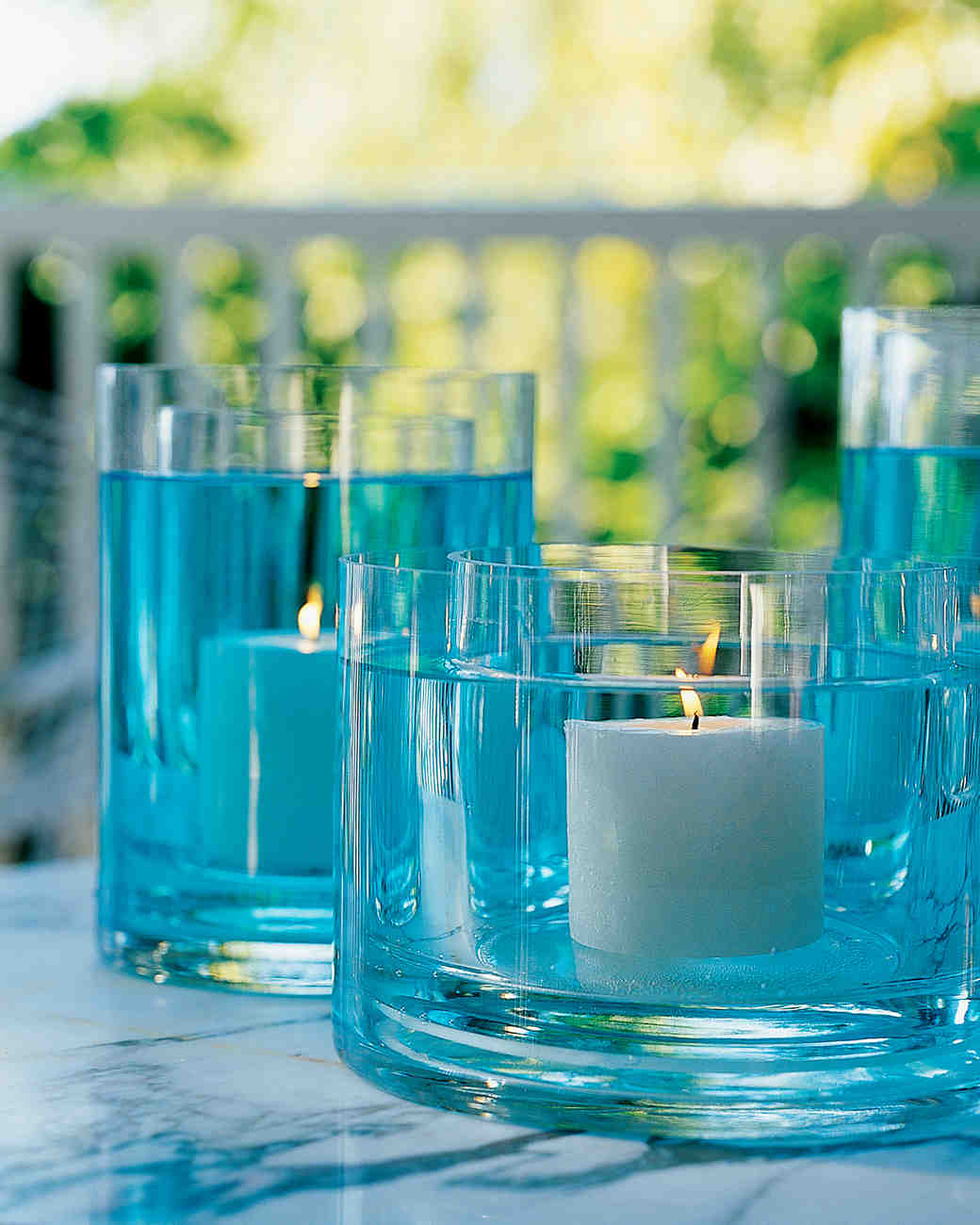 Floating Candles in Blue Vessels