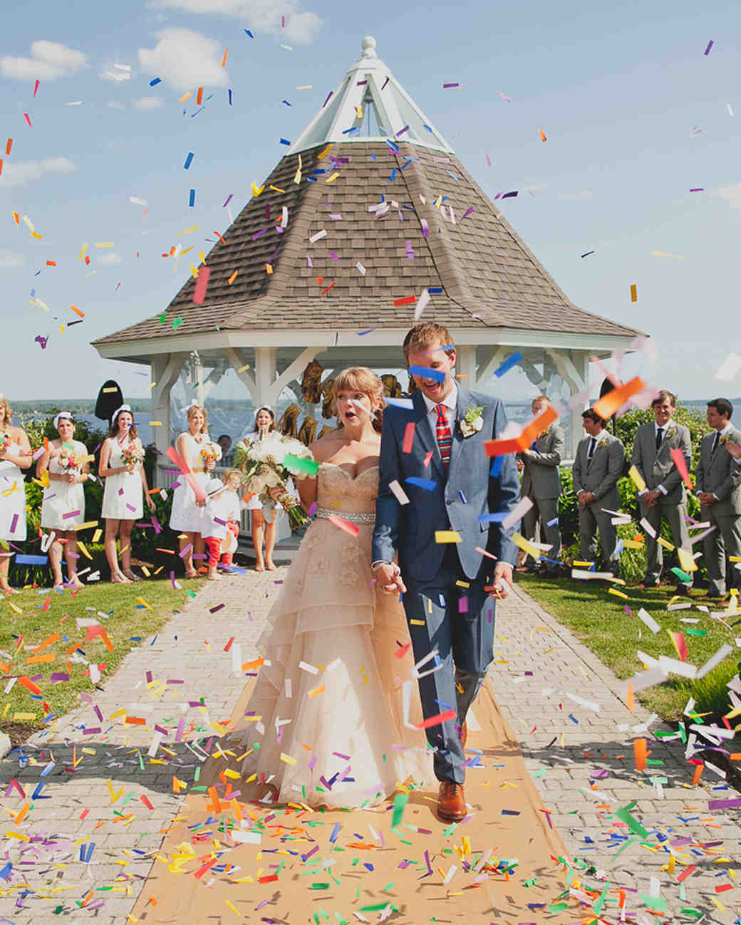 Bride and Groom Walking Through Rainbow Confetti