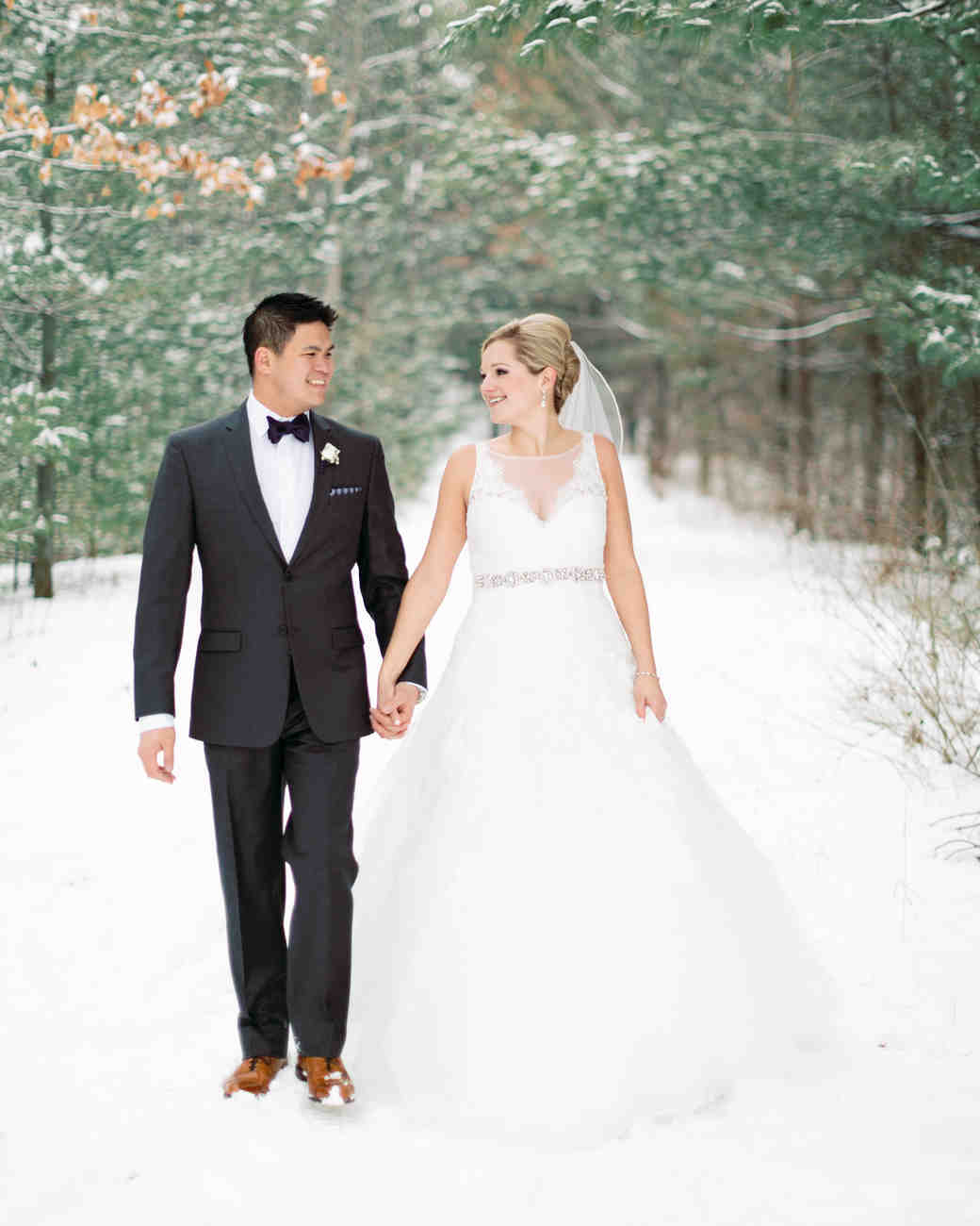 Bride and Groom Walk in Snow