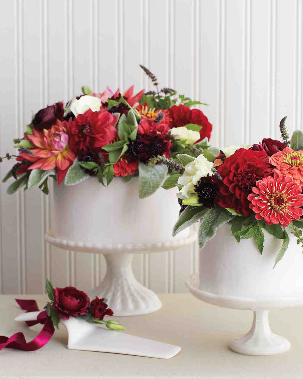 White Single-Tiered Wedding Cake with Red Floral Bouquet Topper