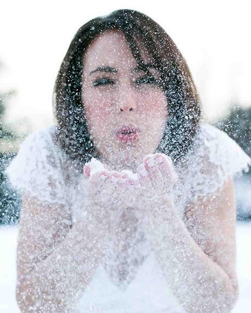 Bride Blowing Snow