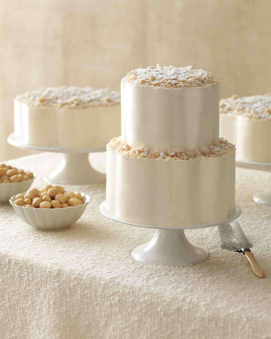 Two-Tiered White Wedding Cake Scattered with Nuts