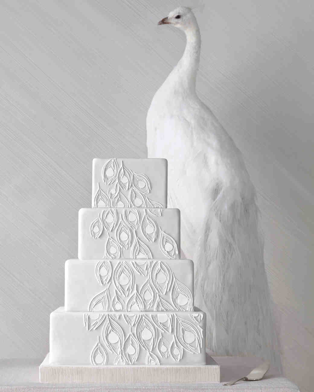 Four-Tiered White Wedding Cake with Feather Design