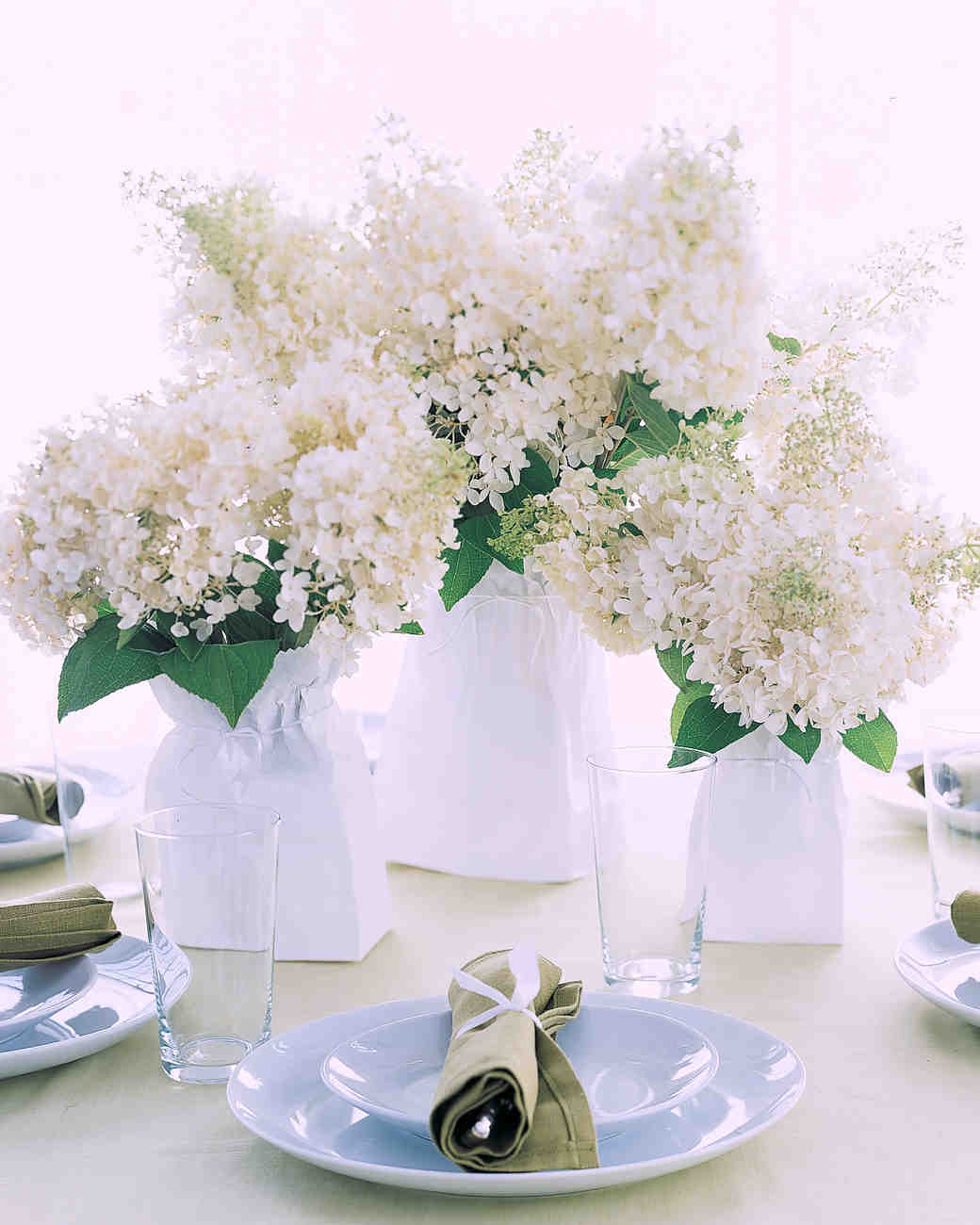 This is my favorite Inexpensive Table Centerpiece for Spring and Summer events. Who knew that cheap centerpiece ideas using Wheat Grass could be this simple, yet pack such a punch?