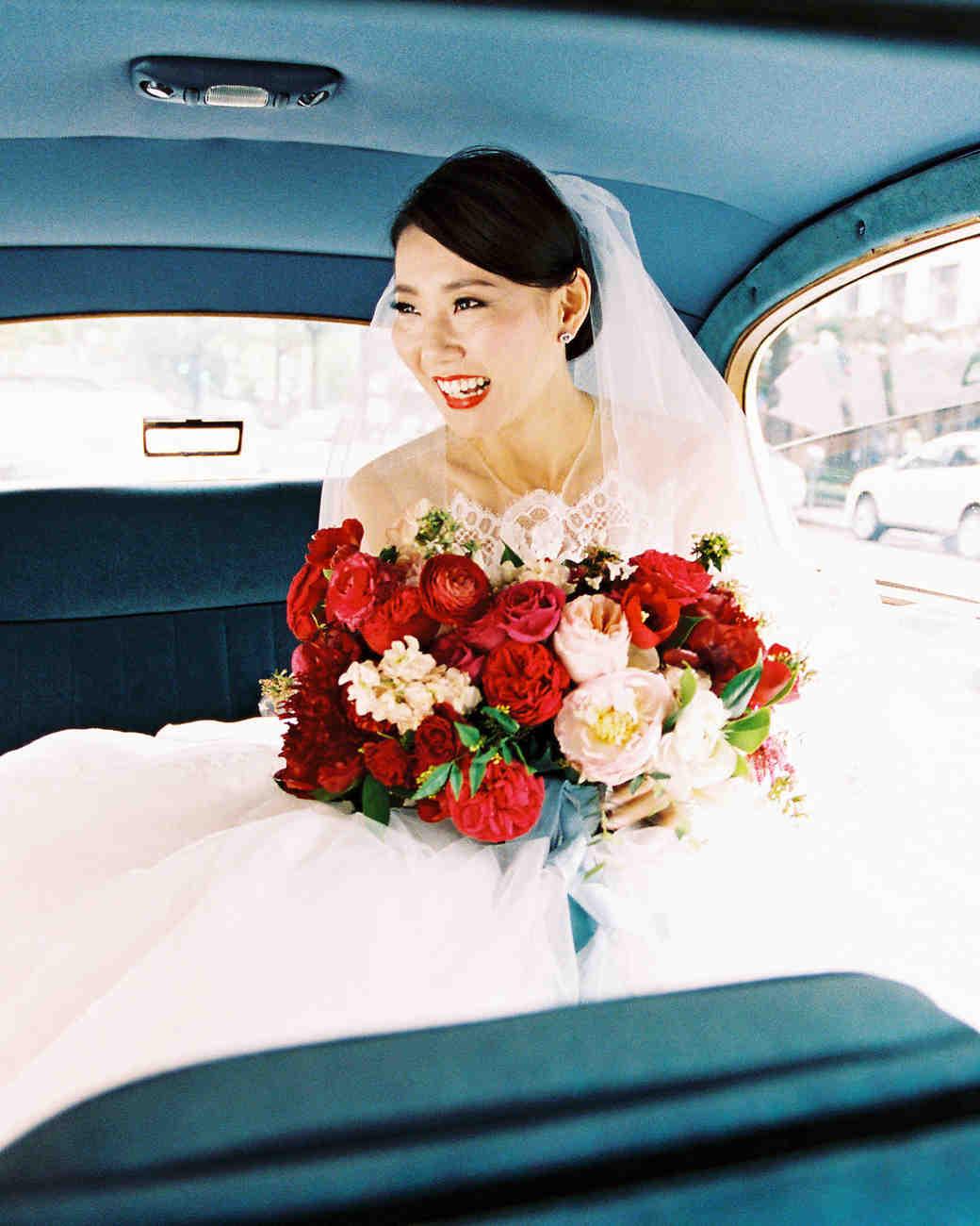bold lipstick bride in back seat of vintage car