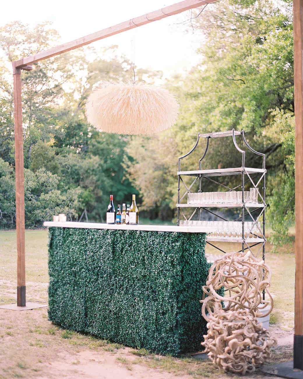 outdoor bar covered in greenery