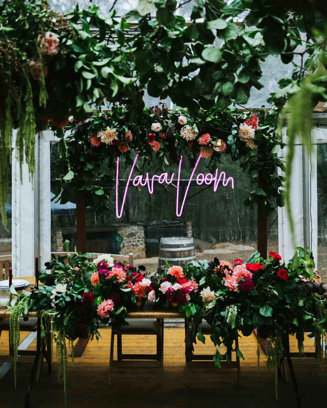vava voom neon sign in reception floral decor