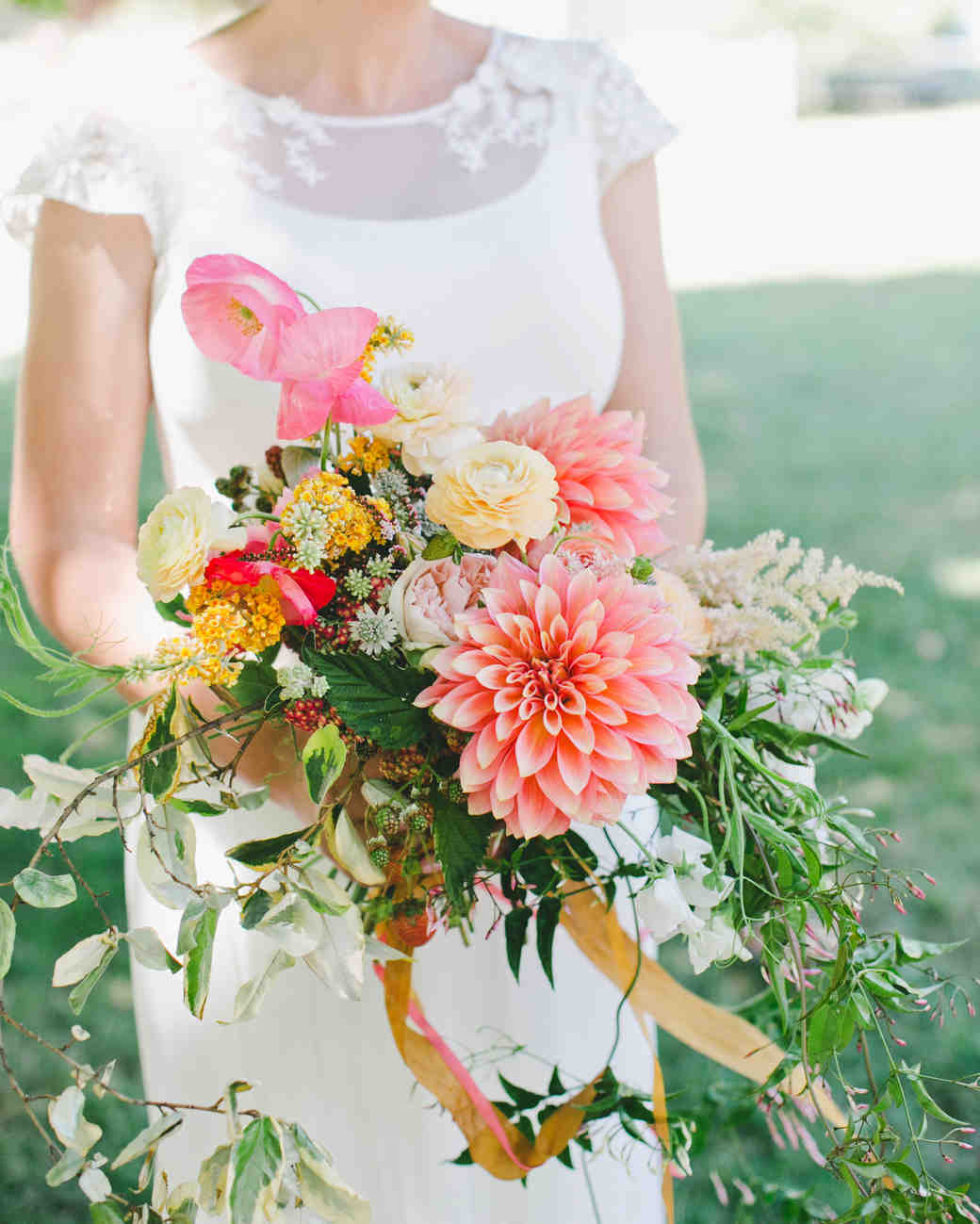 36 dreamy dahlia wedding bouquets martha stewart weddings bride with dahlia bouquet orange yellow white izmirmasajfo