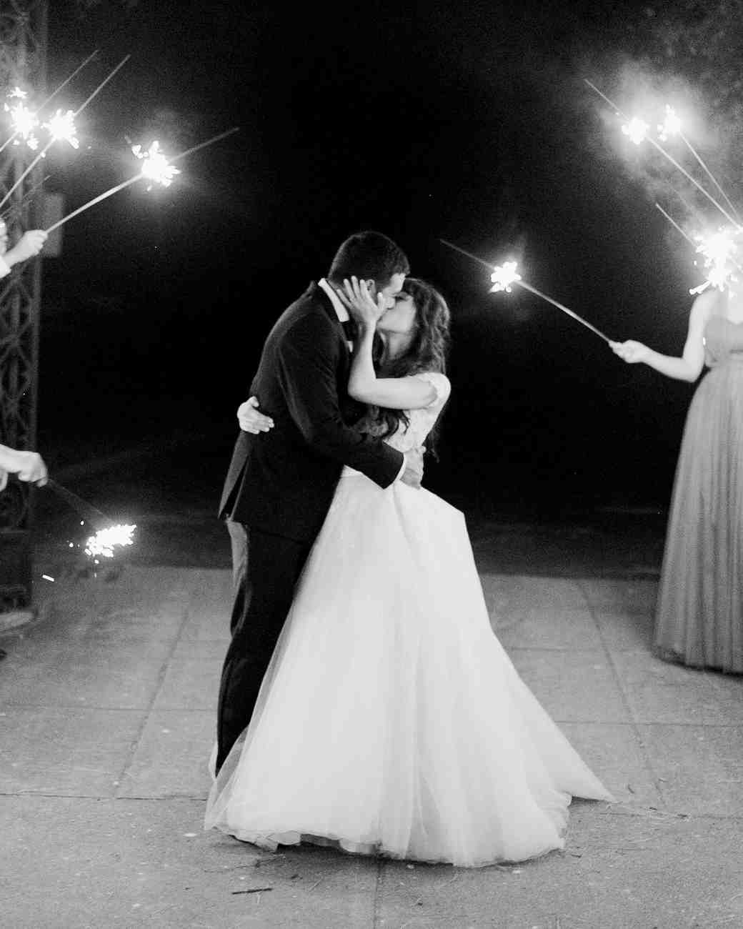 molly josh wedding couple kissing sparkler exit
