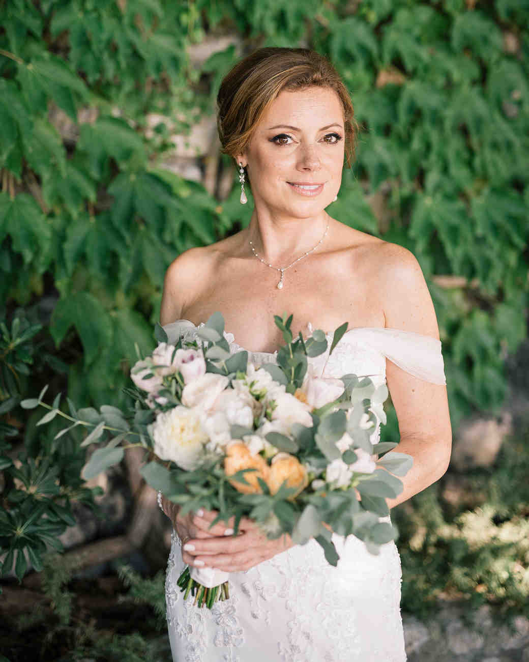 cara david wedding bride in front of greenery