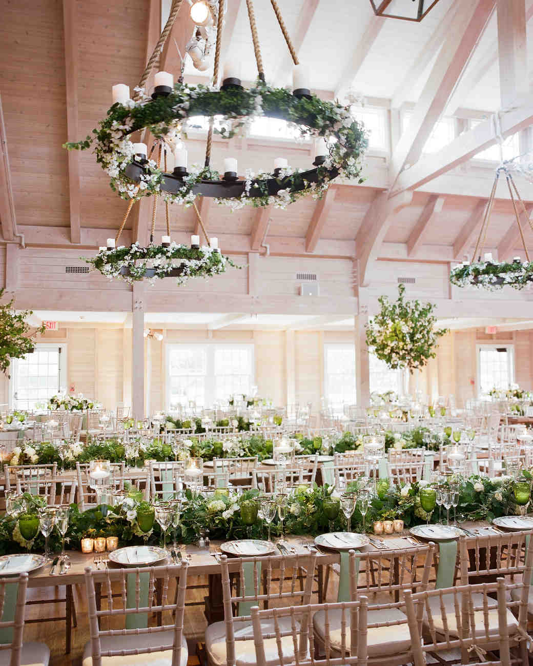 wedding chandelier iron with greenery hung with rope
