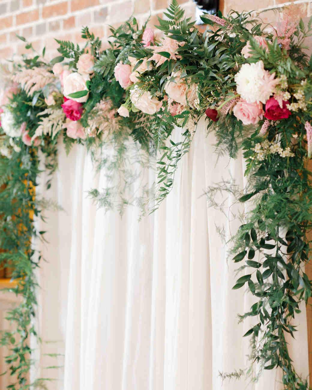 ryan thomas wedding arch with flowers