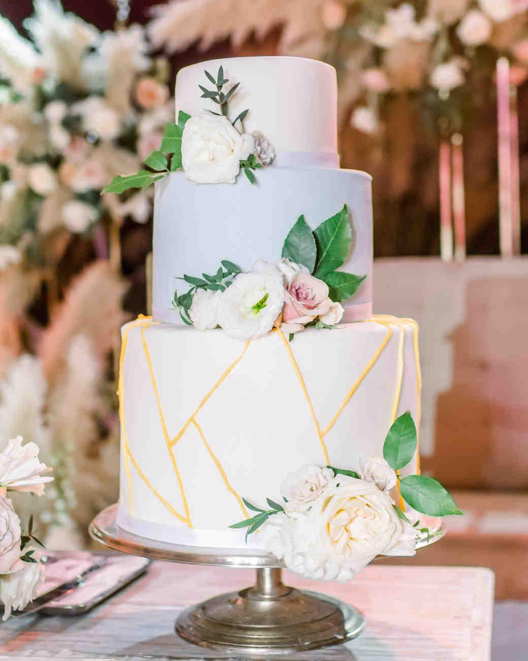 three tiered geometric design wedding cake with rose embellishments