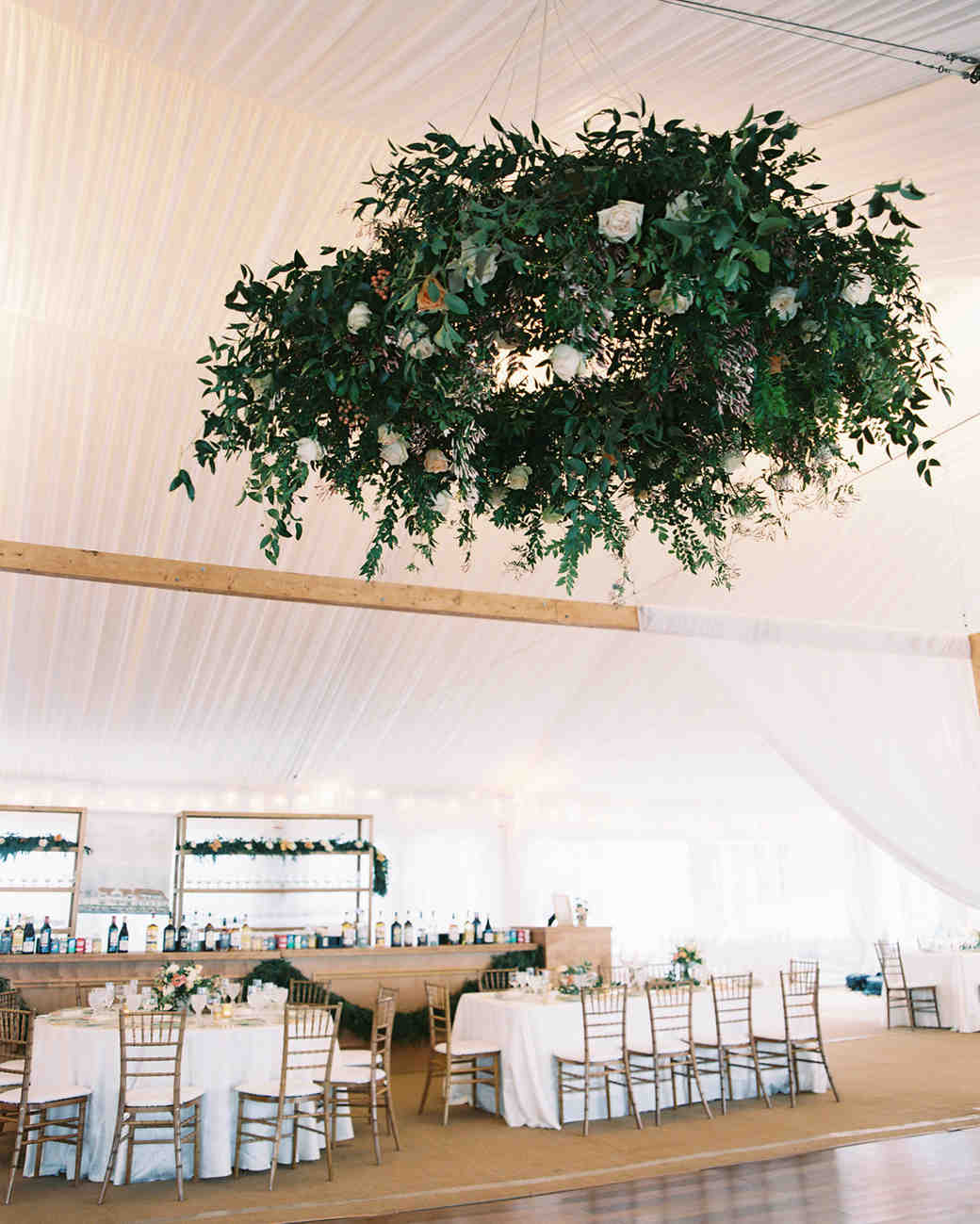 wedding wreaths foliage and white roses hanging from ceiling