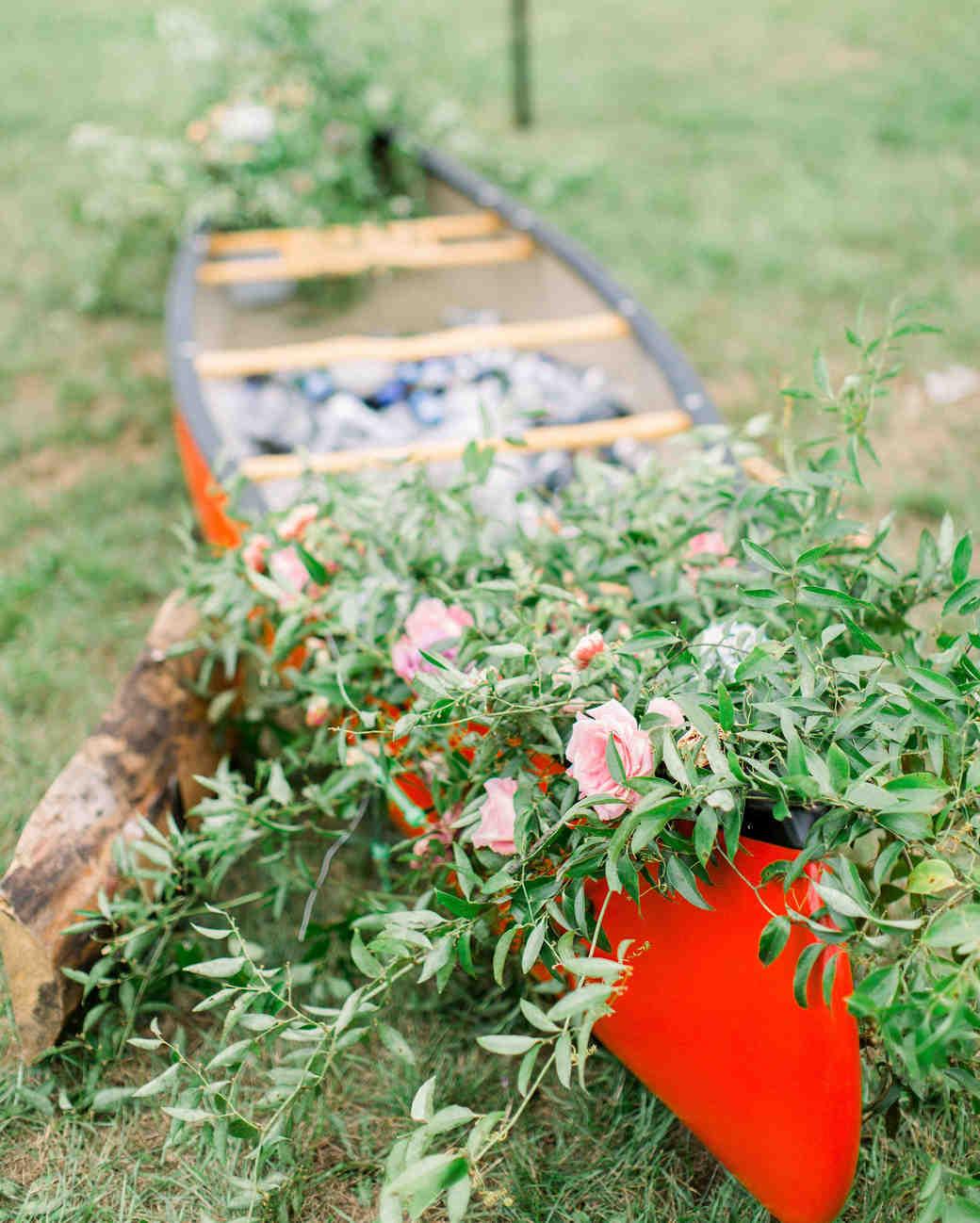 lauren josh wedding red canoe with flowers