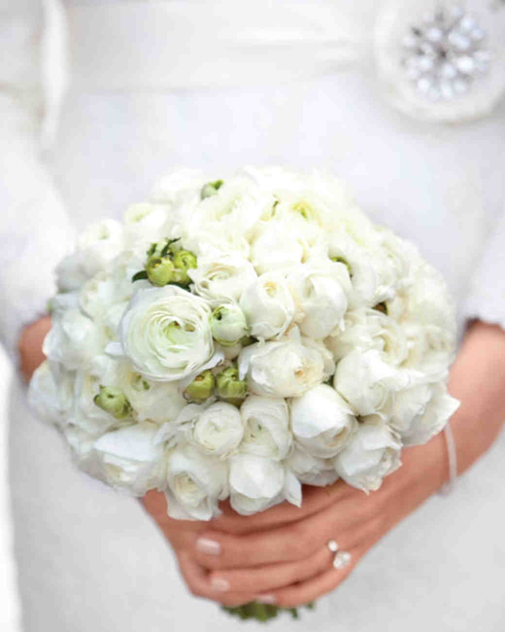 brides bouquet of white roses garden roses and peonies white