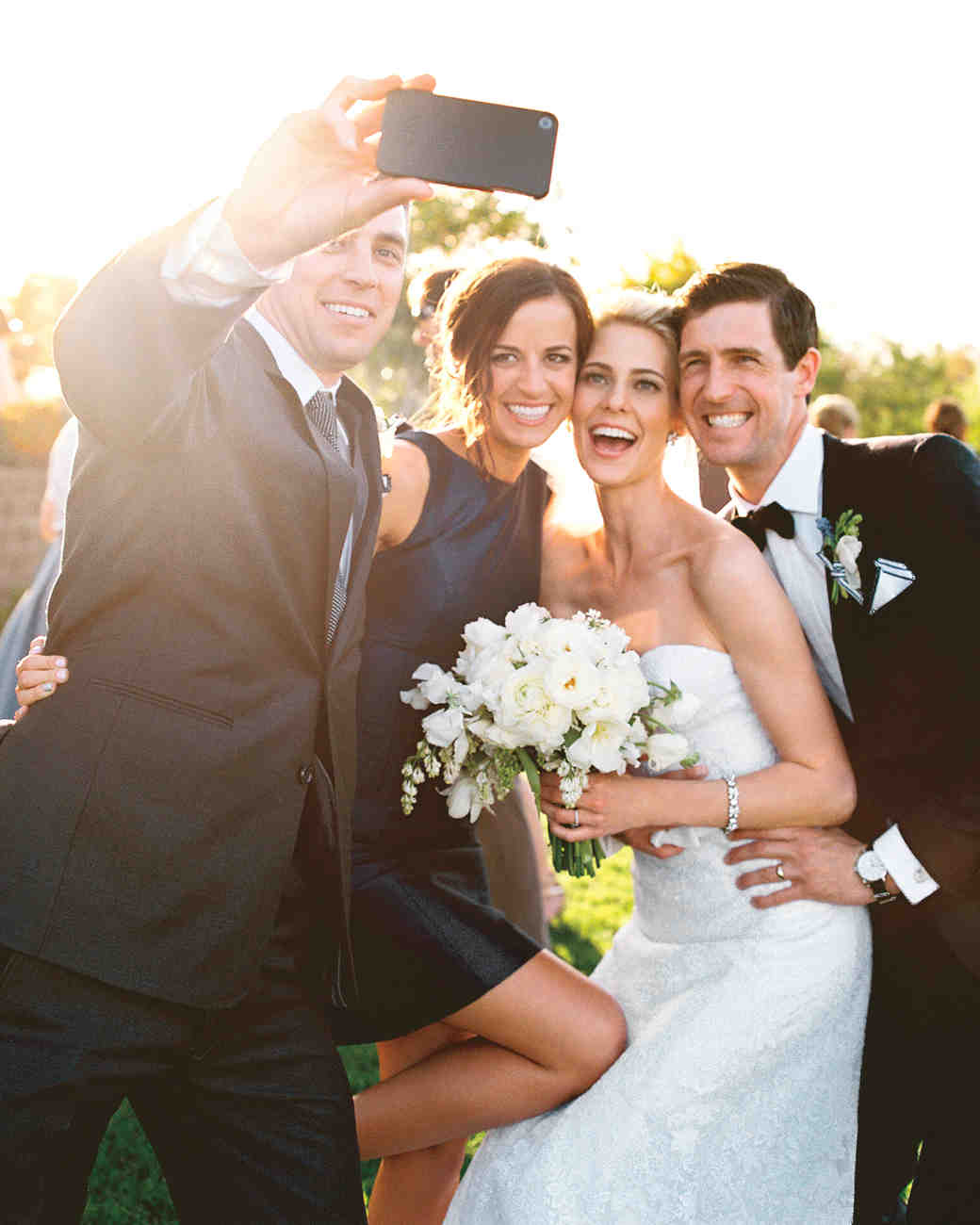 couple and guests taking a selfie