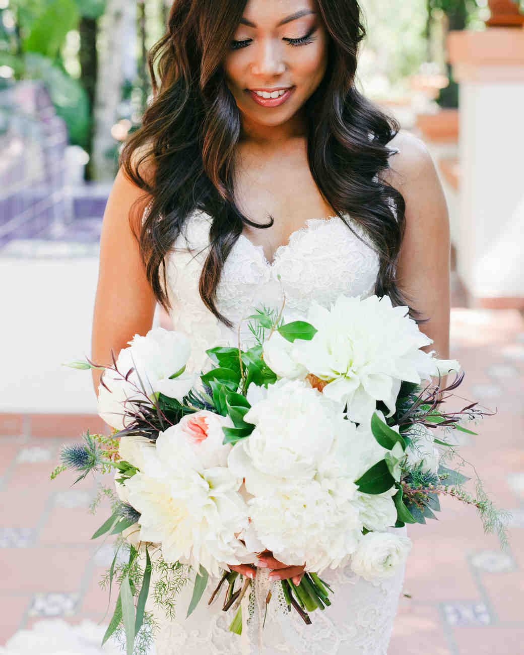 bride with dahlia bouquet white flowers green
