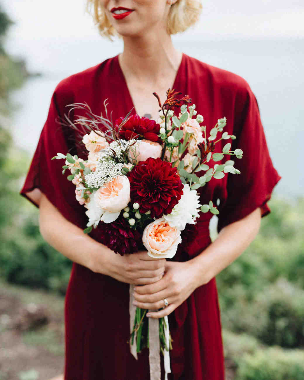 bride red dress dahlia bouquet dark burgundy peach flowers