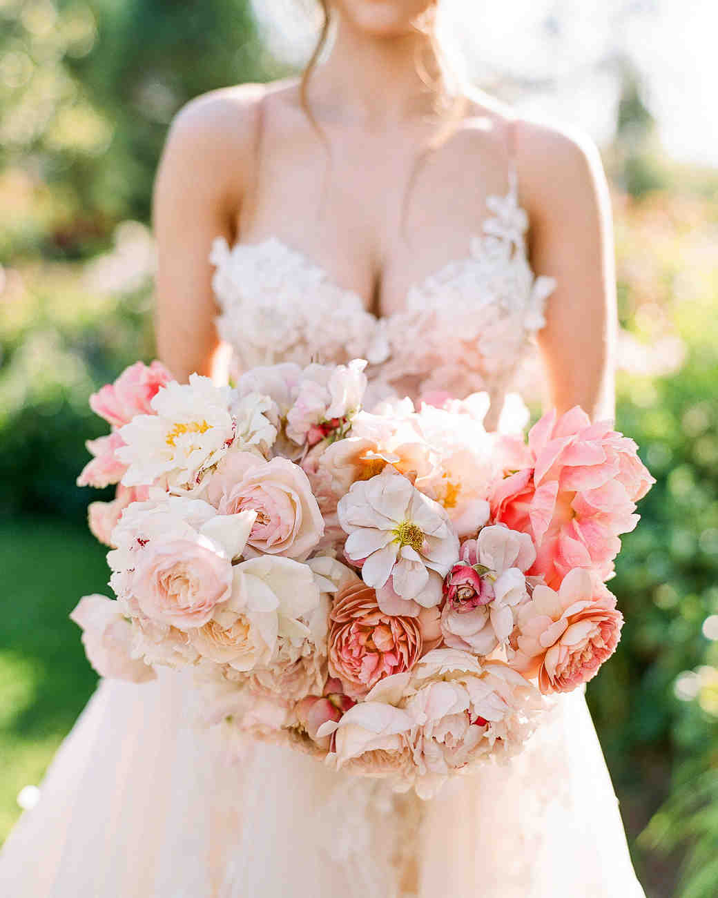 peony bouquets muted pink-and-white peonies, roses, and cosmos to mimic the fluffy dress bodice
