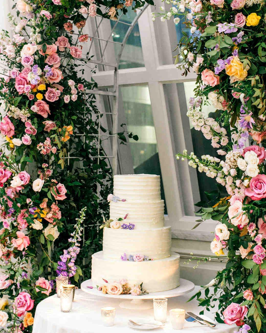 stephanie joe wedding cake and floral arch