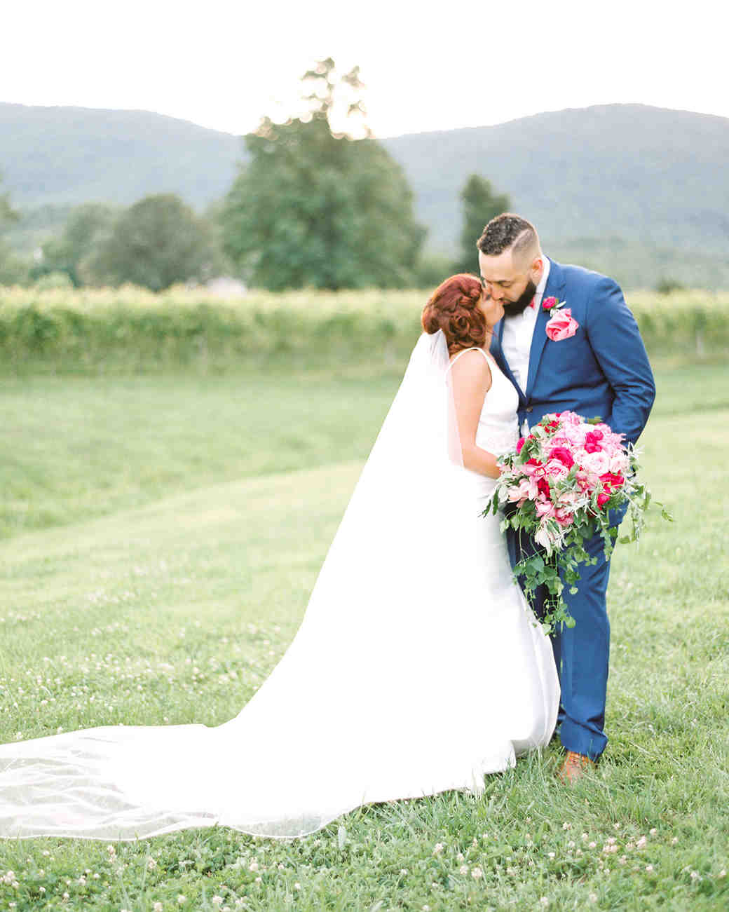 dawn rich wedding couple kissing in field