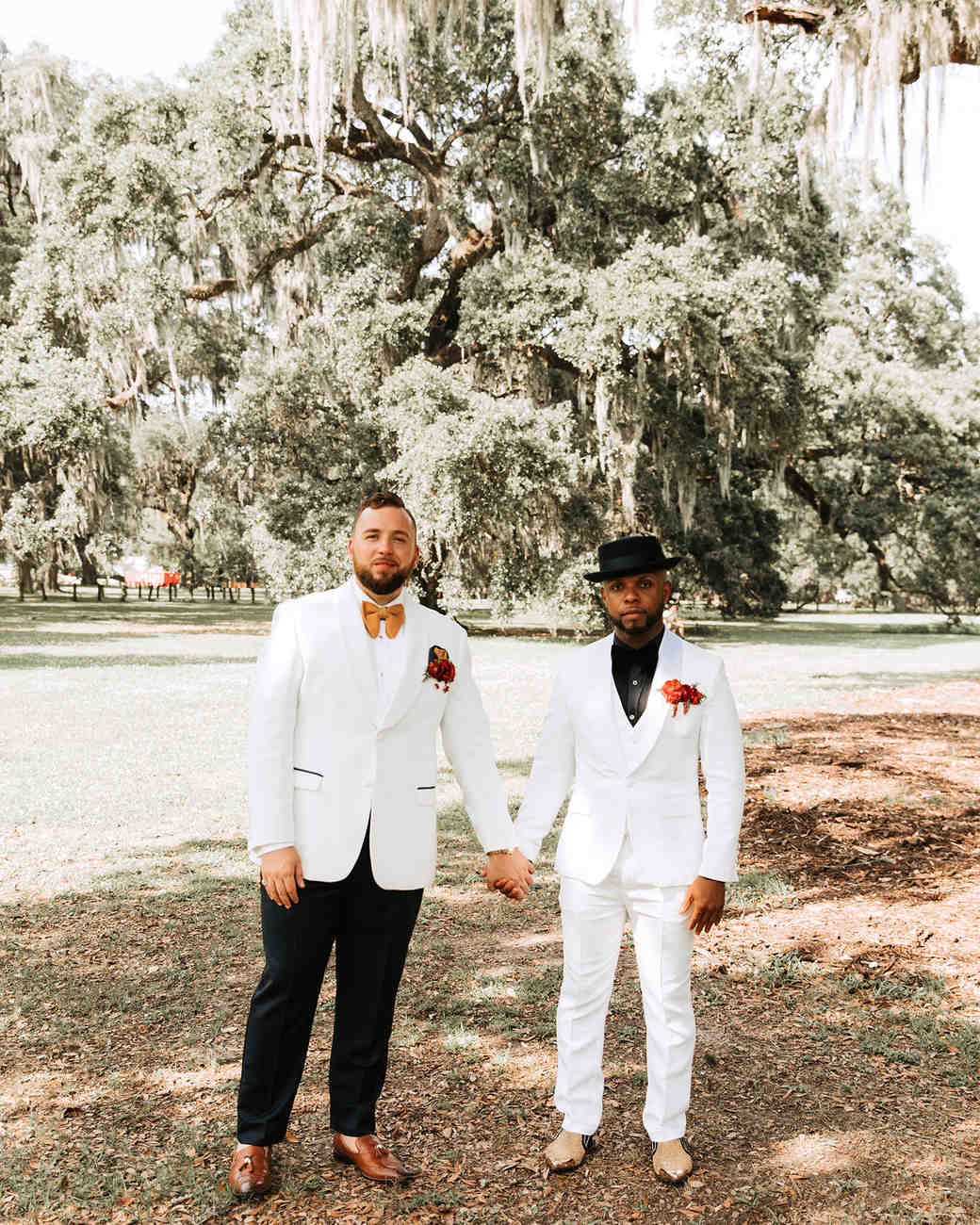 joe tim new orleans wedding grooms holding hands